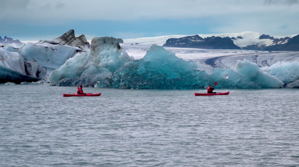 Kayaking under jokulsarlon clacier in iceland