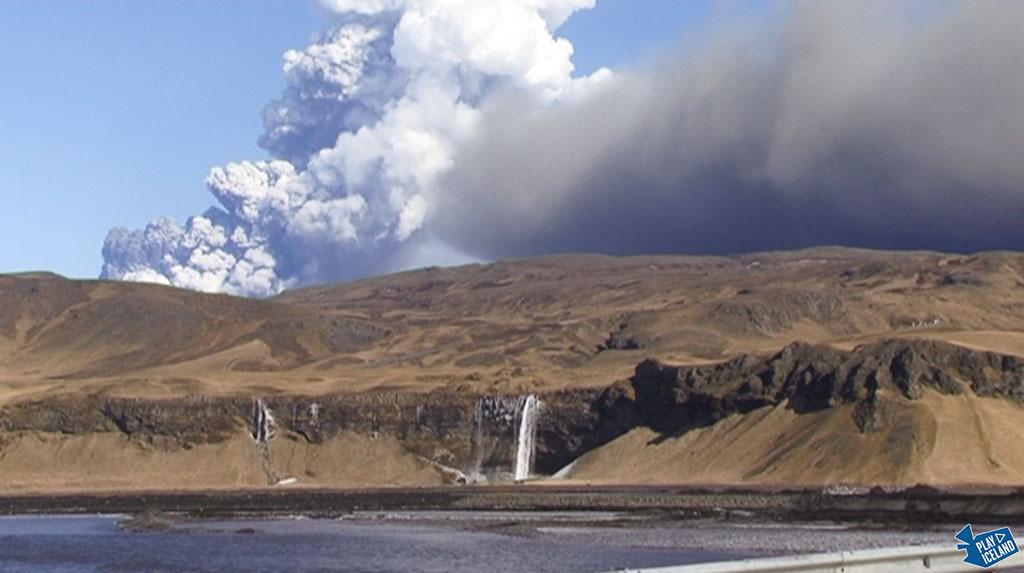 Eyjafjallajokull volcano over Seljalandsfoss Iceland