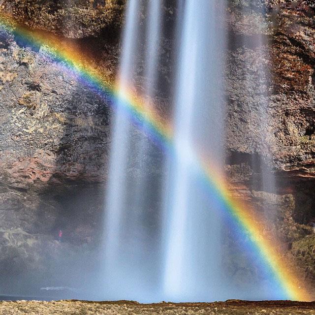 Rainbow behind Seljalandsfoss Iceland